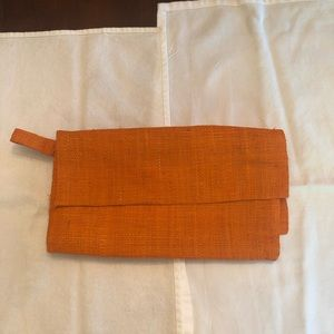Orange Woven Clutch with flap and zippered closure
